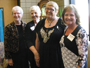 Group of four women smiling
