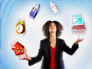 Woman in a blazer juggling things including house, phone, clock, laptop and baby bottle.