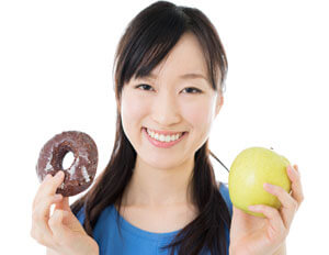 woman with donut and apple