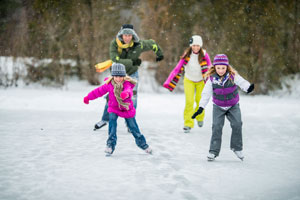 children skating in snow
