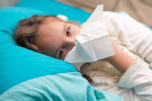 sick child with tissue