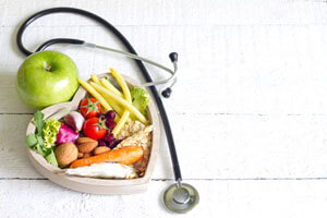 Foods in a heart shape with a stethoscope.