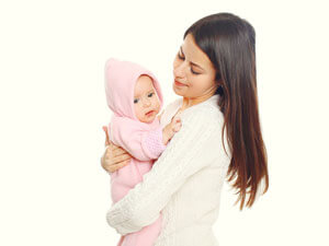 Woman with dark hair holding baby.