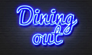 The words dining out in neon