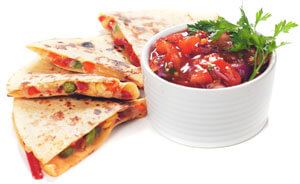 Quesadilla and a white bowl of salsa.