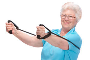 elderly woman using exercise bands
