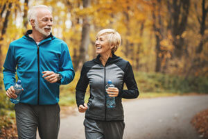 Older couple power walking