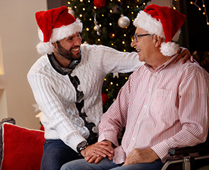 young man and older man in santa hats