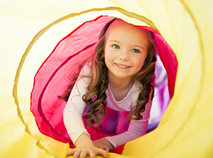little girl playing in tunnel