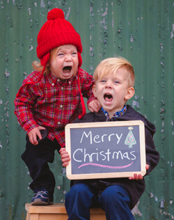 kids taking Christmas picture