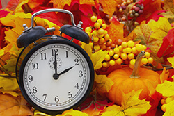 clock among fall leaves
