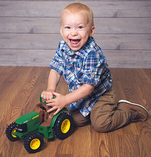 cooper playing with toy tractor