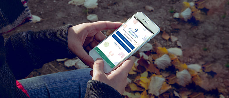 woman looking at her phone on the CentraCare Carefinder app