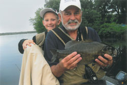 Jim enjoys fishing with his grandson Max.